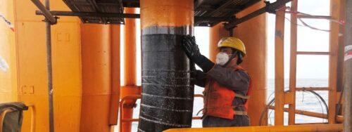 Offshore contractor applying Belzona Superwrap II to a riser