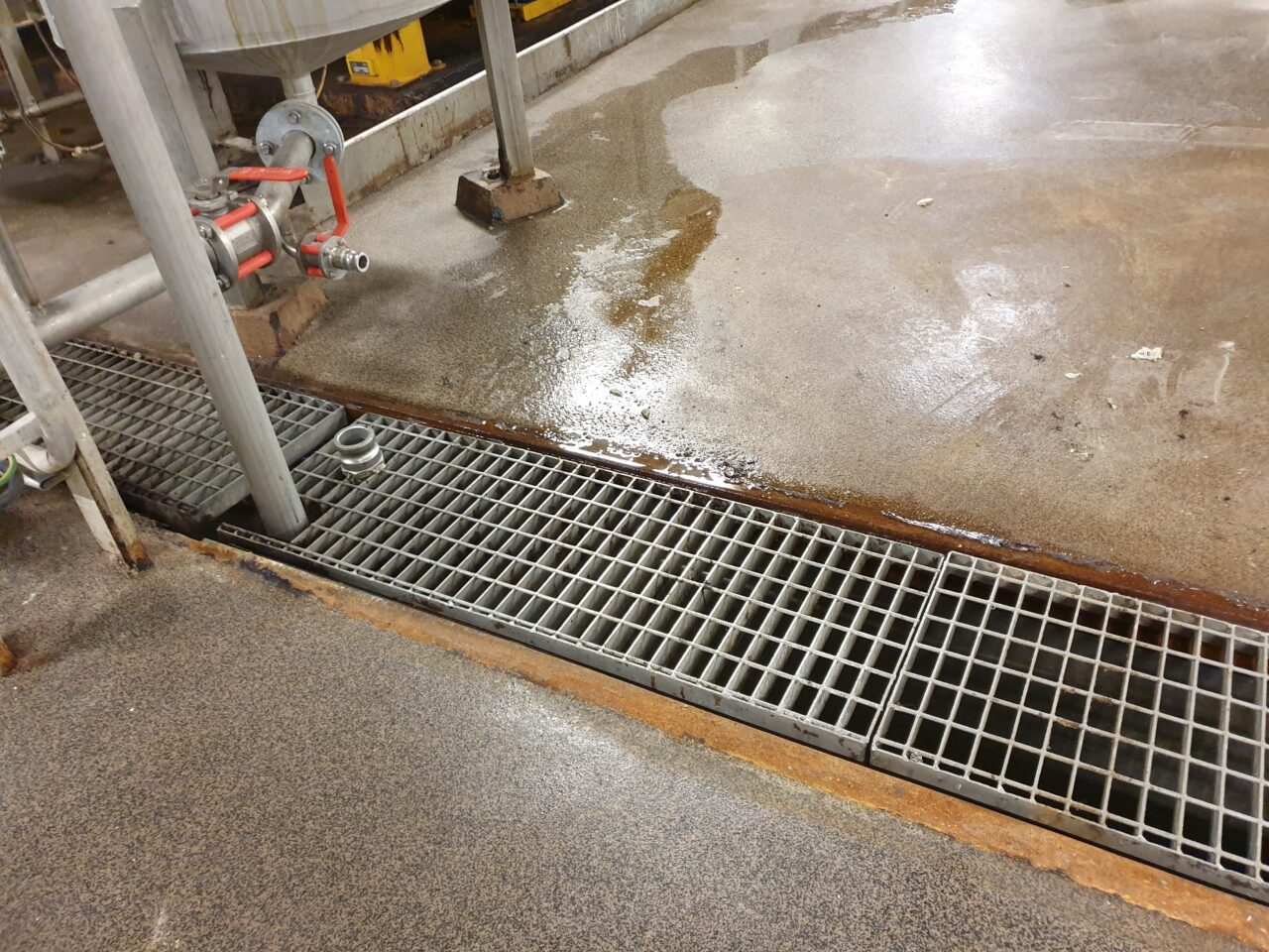 Deteriorated drain channels in need of chemical protectio