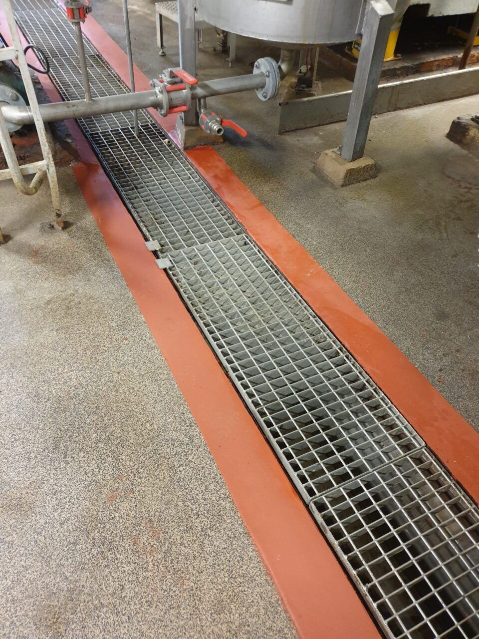 Drain channel protected with chemical resistant coating