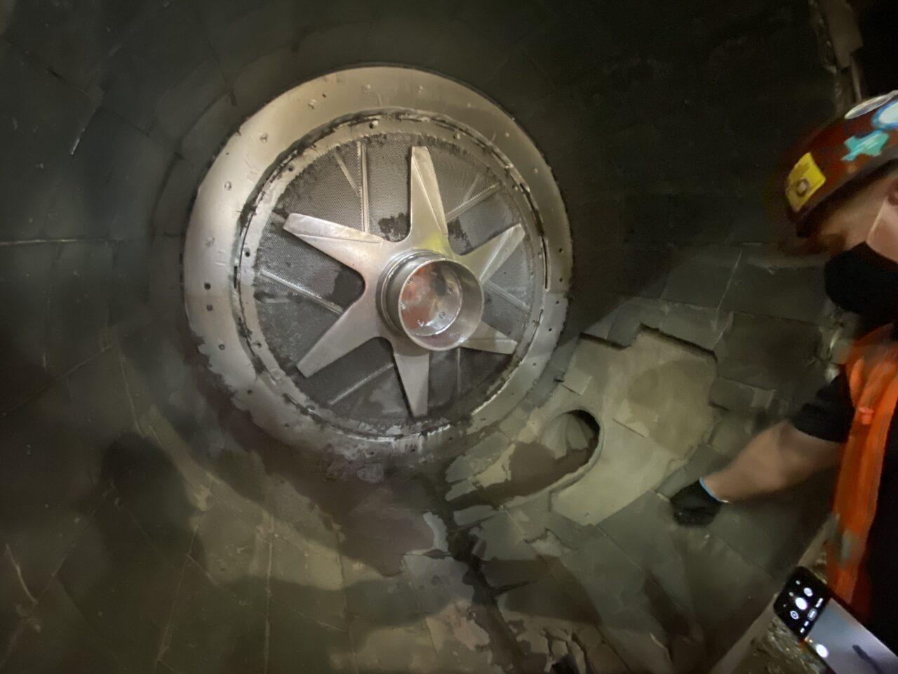 Internal view of turbo separator showing damaged tiles